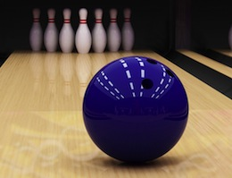 Bowling ball going down lane